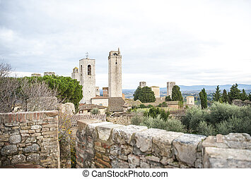 panoramic view with towers and bell tower in Tuscany