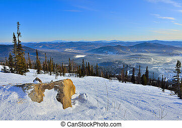 Panoramic winter landscape in the mountains of Western Siberia, Russia