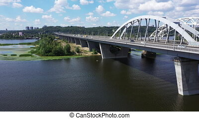 Panoramic Drone Shot over the Darnytsky Bridge over the river Dnipro in Kiev on a summer day