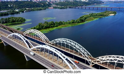 Panoramic Drone Shot over the railroad Bridge over the river Dnipro in Kiev on a summer day