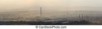 Panoramtic city Ceske Budejovice in winter sunset and strong fog
