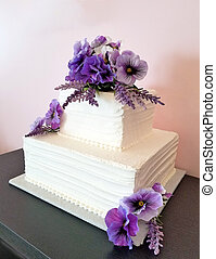pansies on square wedding cake