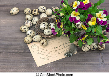 pansy flowers, easter eggs and greeting card