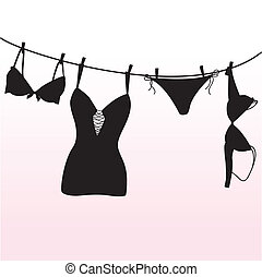 Pantie, bra and lingerie hanging on rope