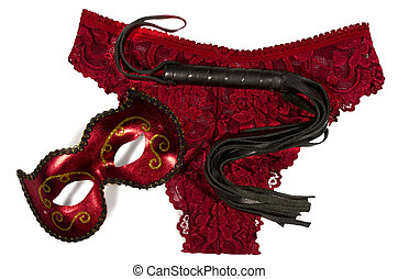 Pantie, mask and leather whip, isolated on white background.