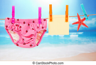 Panties, empty card and starfish on a rope