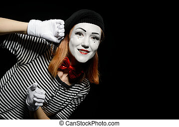 Pantomime actress leaning on wall. Portrait of smiling woman