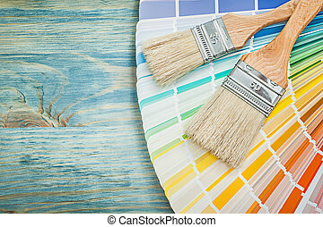 Pantone fan paint brushes on wooden board construction concept