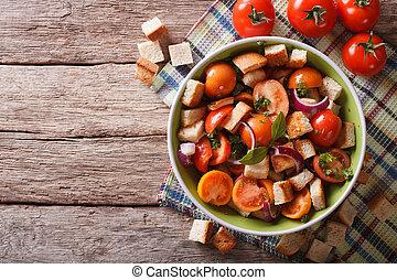Panzanella salad on a plate. Horizontal top view