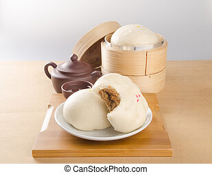 pao or dim sum with chinese tea on background. - pao or dim...