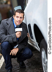 paparazzi hiding behind a car