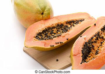 Papaya Halved With A Longitudinal Cut - Papaya halved with a...