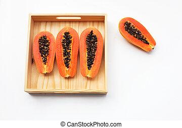 Papaya in wooden box on white background.