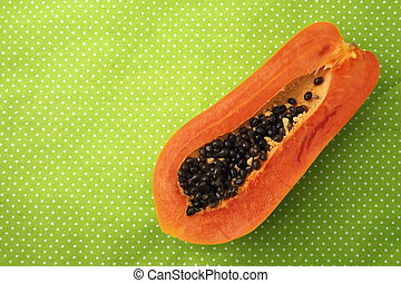 Papaya on the green background