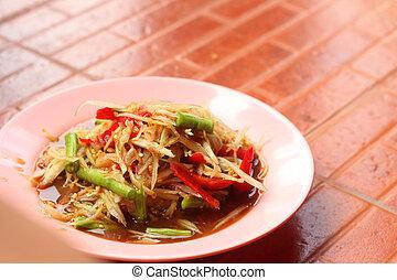 Papaya salad on a plate , Thai food.
