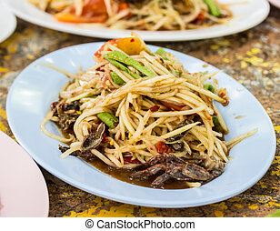 papaya salad with crab on table
