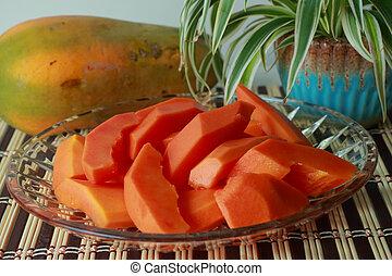 Papaya slices. - Papaya slices on bamboo