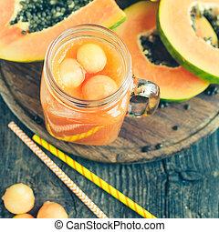 Papaya smoothie in glass jar