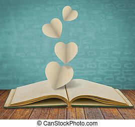 papel, corte, de, corazón, en, viejo, libro