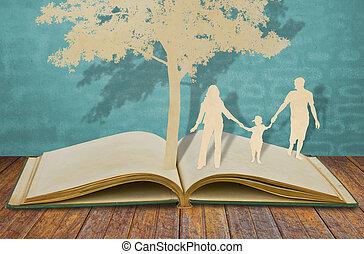 papel, corte, de, familia , símbolo, debajo, árbol, en, viejo, libro