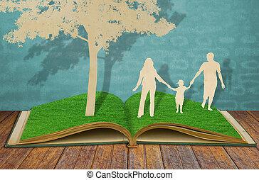 papel, corte, de, familia , símbolo, debajo, árbol, en, viejo, pasto o césped, libro