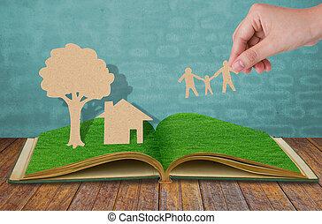 papel, corte, de, familia , símbolo, en, viejo, pasto o césped, libro