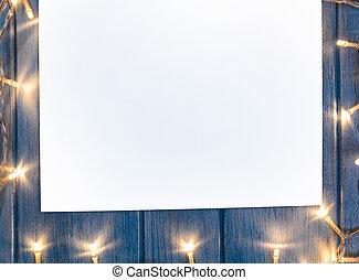 papel, hoja, con, luces de navidad, en, tabla