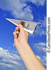 papel, segurando mão, avião