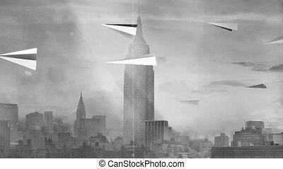 Paper airplanes over New York Harbor