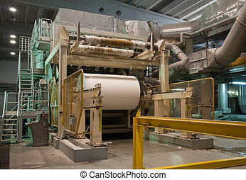 This paper mill is a factory devoted to making paper and cardboard from recycled paper using a Fourdrinier Machine.