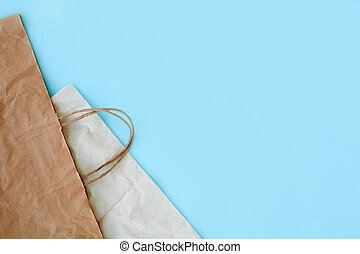 Paper bag on a blue background. Eco, plastic free and save earth concept. Copy space