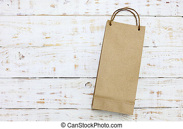 Paper bag on a wooden texture background