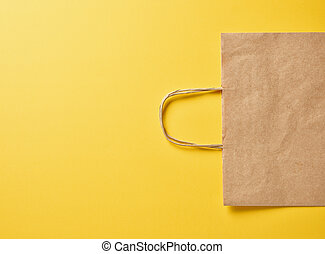 paper bag on yellow background