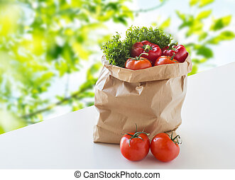 paper bag with fresh ripe vegetables on table - cooking,...