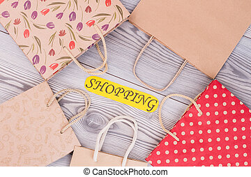 Paper bags and card with inscription shopping.