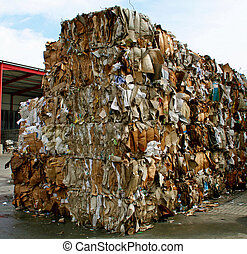 paper bales ready for schredding at recycling plant in...