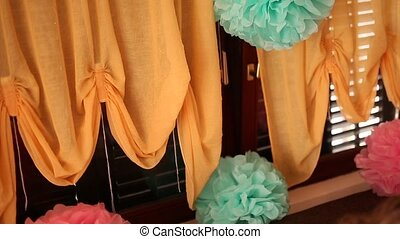 Paper balls hanging on a thread, in window with curtains -...