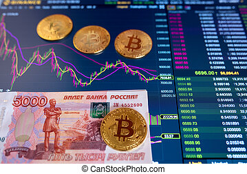 Paper bill Russian Rubles 5000 RUB, blurred background. The electronic schedule of bitcoin on the exchange, volume trades, on the monitor lie gold coins bitcoin.