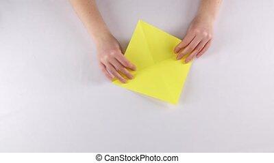 Paper birds. Origami. White. Time lapse - Girl makes bird...