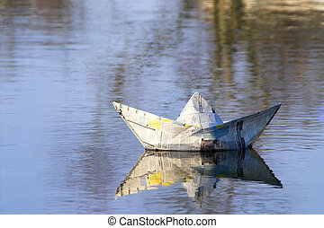Paper Boat - A paper boat sailing on the high seas.