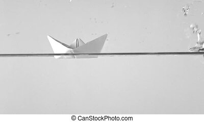 Paper boat blown away by storm, super slow motion shot clip