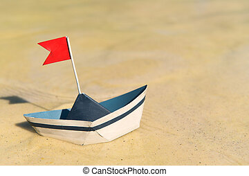 Paper boat floating on water - Blue and white paper boat ...
