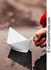 paper boat on fire