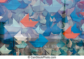 Paper boat on the background of a window. beautiful romantic melancholic composition. close-up, soft selective focus