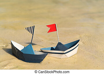 Paper boats floating on water - Blue paper boats floating on...