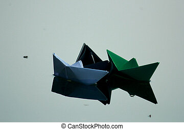 Paper boats floating on water