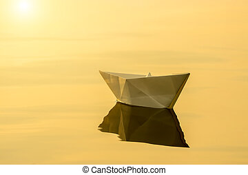 paper boats on the water.