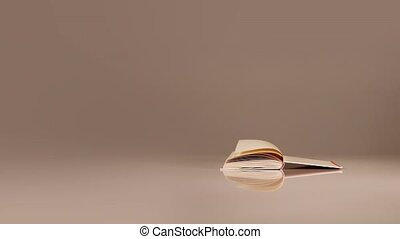 Paper book pages turned by strong wind in different ways and reflected on white table surface against grey wall close view