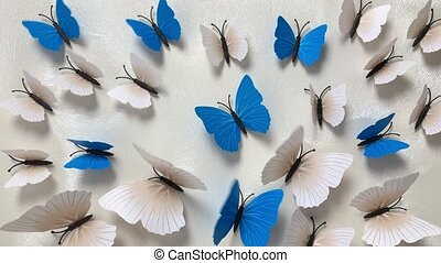 Paper butterflies white and blue gradually appear and begin ...