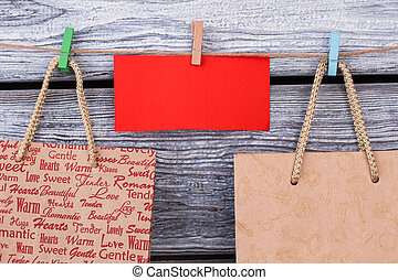 Paper carrier bags on wooden background.